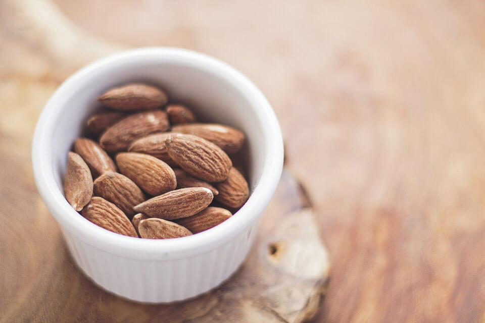use almond oil as one of your home remedies for hair growth