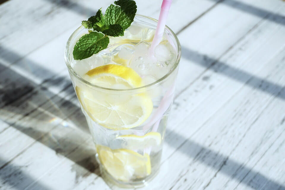 experience the benefits of drinking lemon with water
